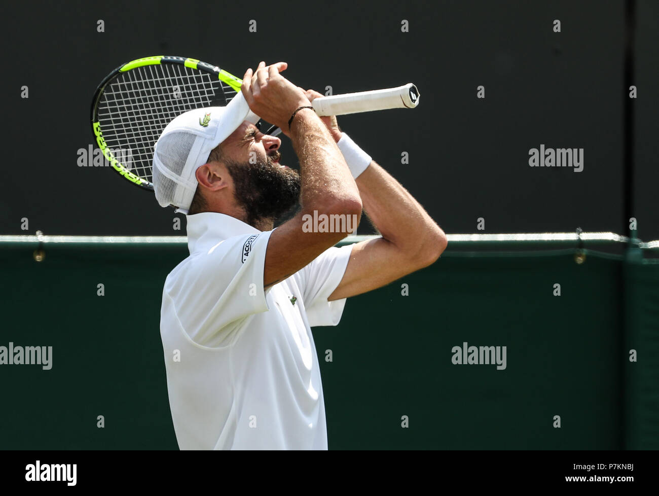 London, UK. 7th July 2018. Benoit Paire of France reacts during the men's singles third round match against Juan Martin Del Potro of Argentina at the Wimbledon Championships 2018 in London, Britain, July 7, 2018. Benoit Paire lost 0-3. (Xinhua/Tang Shi) Credit: Xinhua/Alamy Live News  Stock Photo