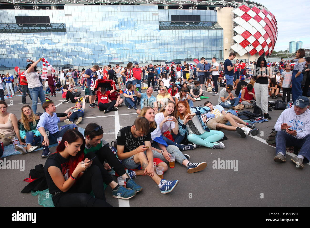 Moscow, Russia. 07th July, 2018. MOSCOW, RUSSIA - JULY 7, 2018: Football fans at a newly opened additional FIFA Fan Zone outside Spartak Stadium. Alexander Shcherbak/TASS Credit: ITAR-TASS News Agency/Alamy Live News - Stock Image