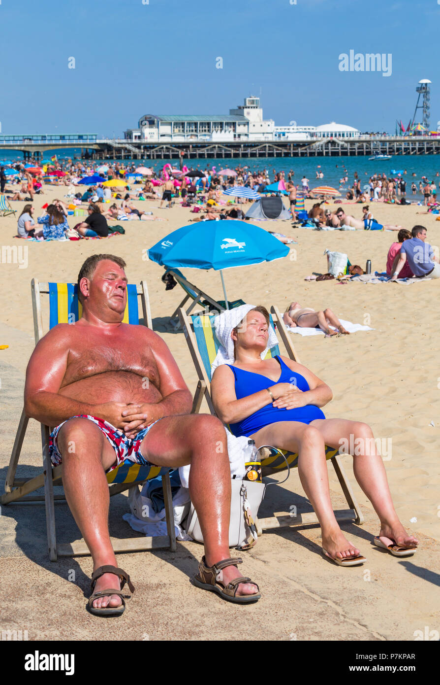 Bournemouth, Dorset, UK. 7th July 2018. UK weather: another hot sunny day as the heatwave continues and thousands of sunseekers head to the  seaside to enjoy the sandy beaches at Bournemouth even with the big match on! Credit: Carolyn Jenkins/Alamy Live News Credit: Carolyn Jenkins/Alamy Live News Credit: Carolyn Jenkins/Alamy Live News - Stock Image