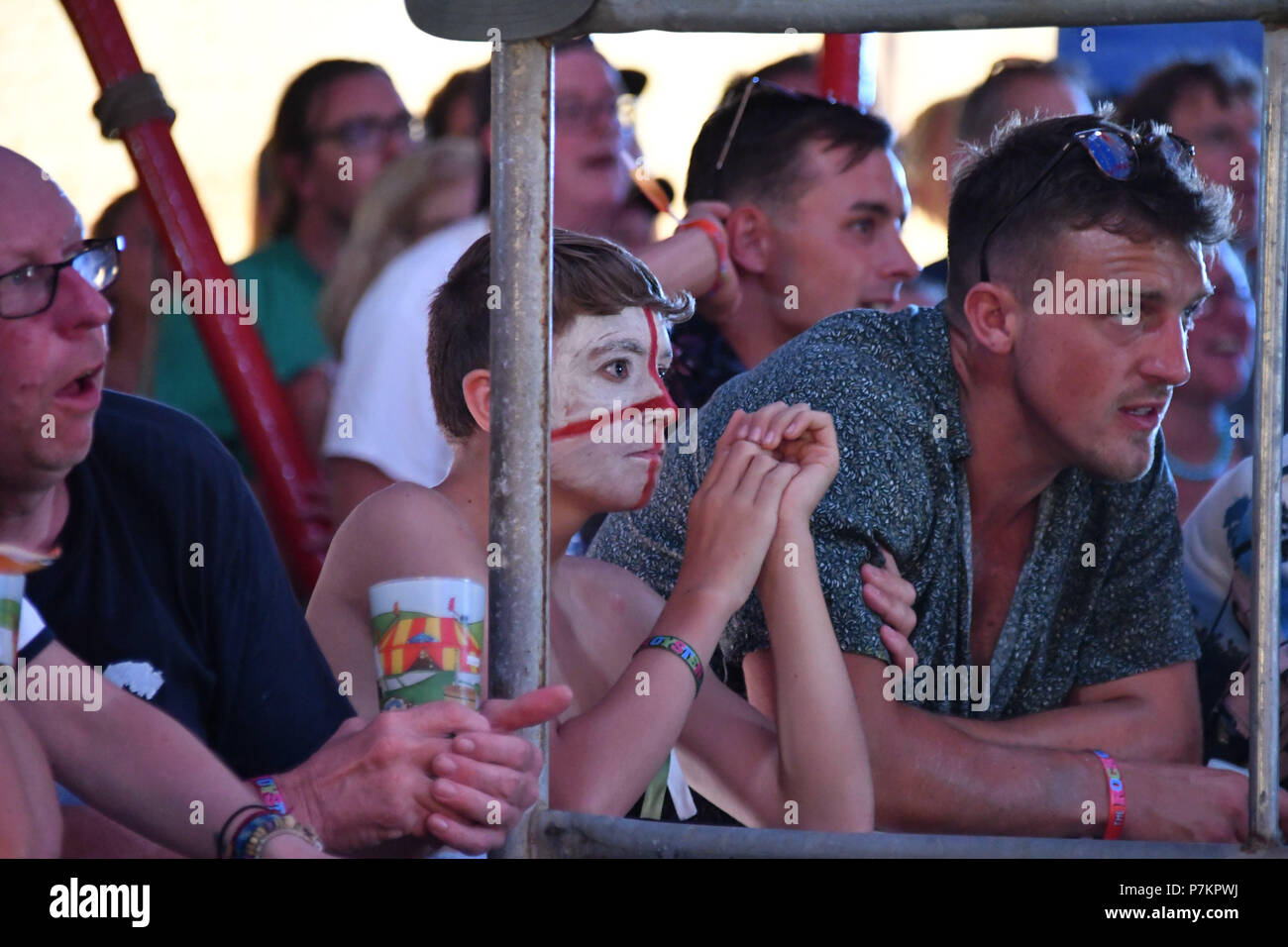 Wadebridge, Cornwall, UK. 7th July 2018. The organisers of the annual Rock Oyster Festival had the foresight to setup a screen for the England Football game. Seen here fans waiting the final moments, then the full time whistle. Credit: Simon Maycock/Alamy Live News - Stock Image
