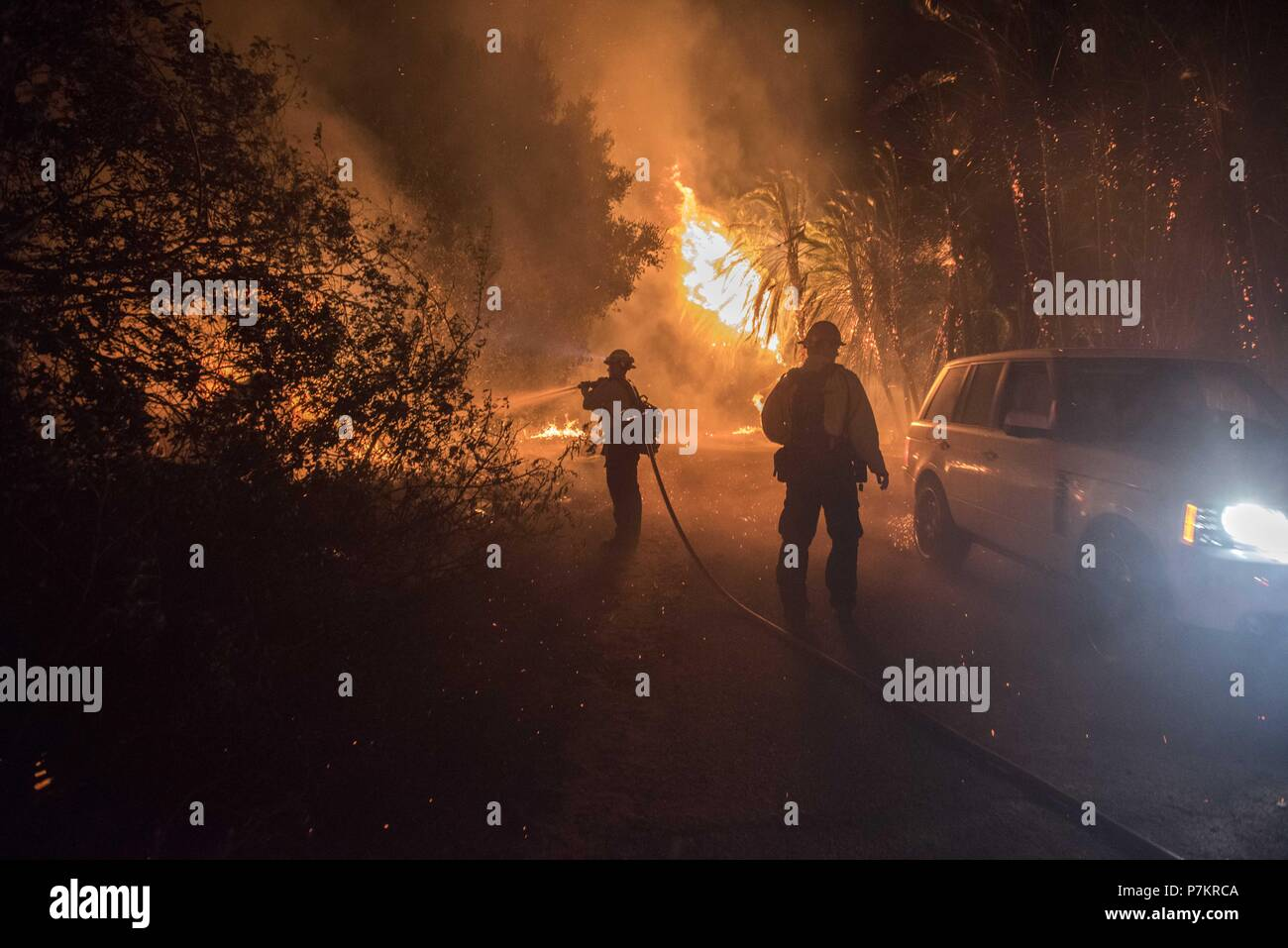 Goleta, California, USA. 6th July, 2018. Firefighters fight the Holiday Fire as residents evacuate the area north of Fairview Avenue Friday evening. Amid a record-setting heat wave in Southern California, the Holiday Fire burned up to 20 structures and 2,000 people were evacuated. Credit: Erick Madrid/ZUMA Wire/Alamy Live News - Stock Image