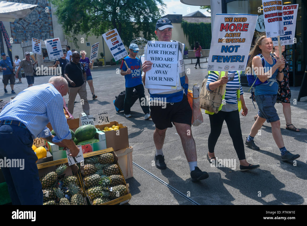 London, UK. 7th July 2018. Keep Our St Helier Hospital (KOSHH) campaigners against the closure of acute facilities at Epsom and St Helier Hospitals in south London celebrate the 70th Birthday of the NHS by marching from Manor Park through Sutton High St to a rally in front of St Helier Hospital.  The closures are prompted by government cuts which call for huge savings by the trust, and would Credit: Peter Marshall/Alamy Live News Stock Photo