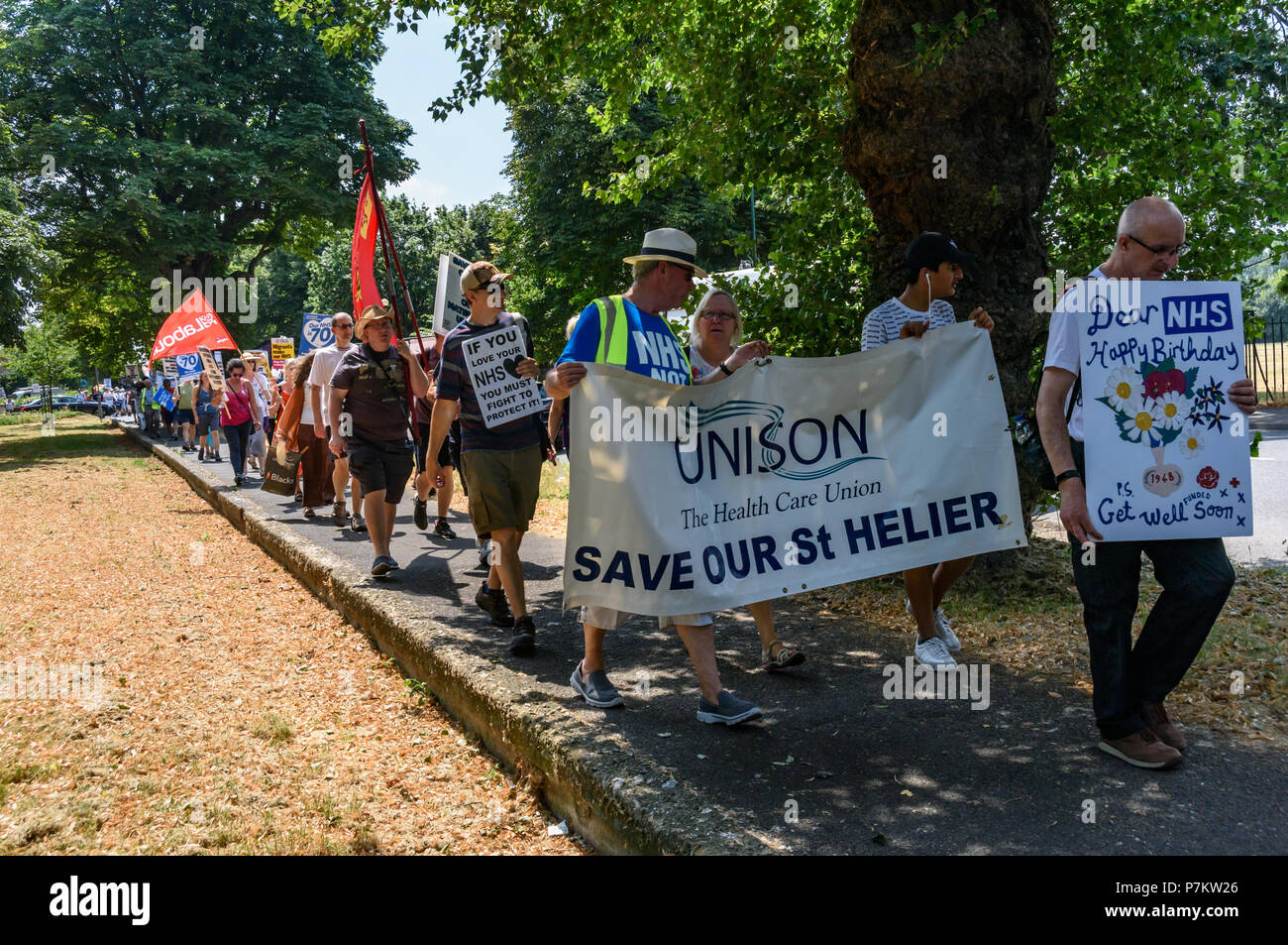 London, UK. 7th July 2018. Keep Our St Helier Hospital (KOSHH) campaigners against the closure of acute facilities at Epsom and St Helier Hospitals in south London celebrate the 70th Birthday of the NHS with a march from Sutton to a rally in front of St Helier Hospital.   he of sou Credit: Peter Marshall/Alamy Live News Stock Photo