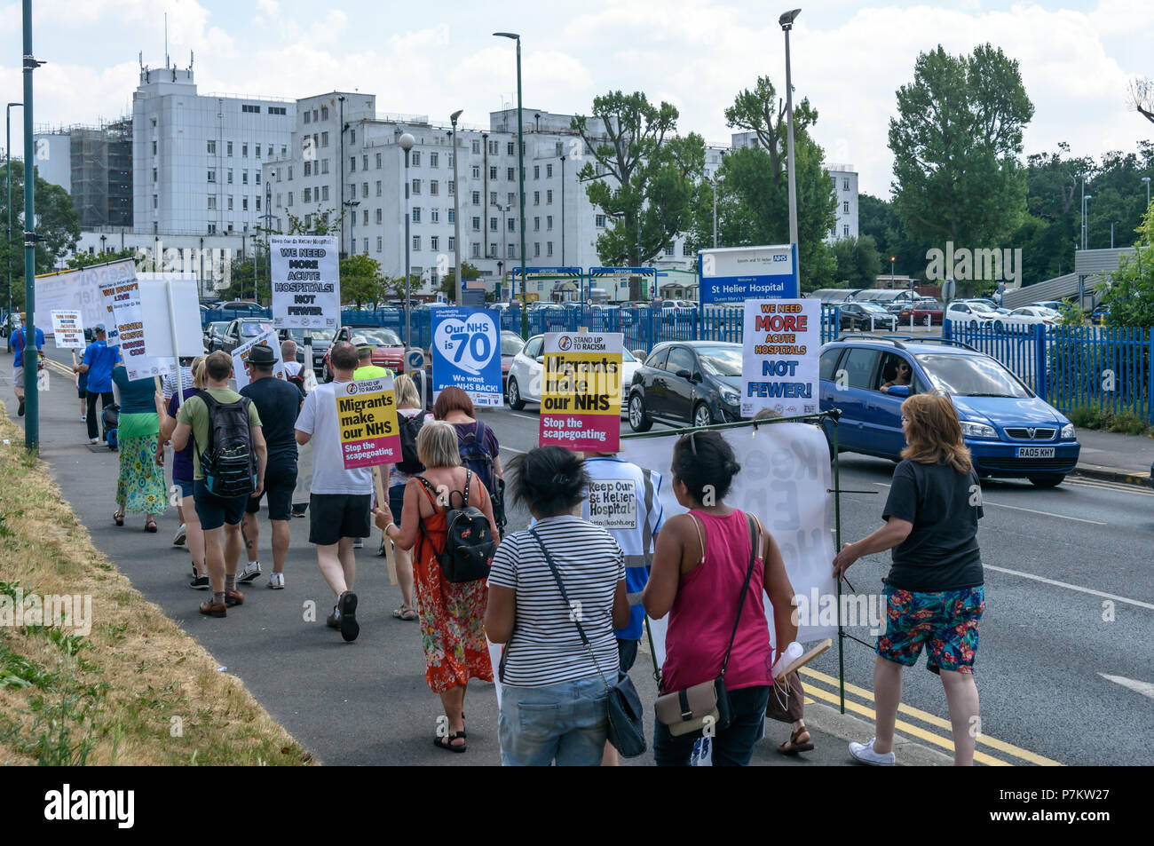 London, UK. 7th July 2018. Keep Our St Helier Hospital (KOSHH) campaigners against the closure of acute facilities at Epsom and St Helier Hospitals in south London celebrating the 70th Birthday of the NHS with a march from Sutton arrive at St Helier Hospital for a rally.   he of so Credit: Peter Marshall/Alamy Live NewsStock Photo
