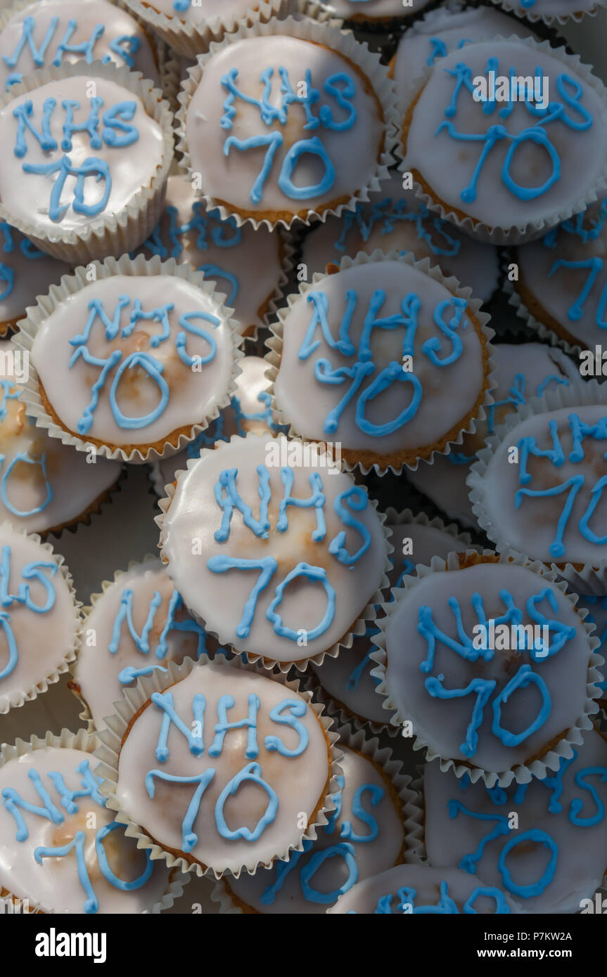 London, UK. 7th July 2018. NHS70 cakes for the Keep Our St Helier Hospital (KOSHH) campaigners against the closure of acute facilities at Epsom and St Helier Hospitals in south London who have celebrated the 70th Birthday of the NHS by marching from Sutton to a rally in front of St Helier Hospital.  The closures are prompted by government cuts which call for huge savings by the trust, and wou Credit: Peter Marshall/Alamy Live News - Stock Image