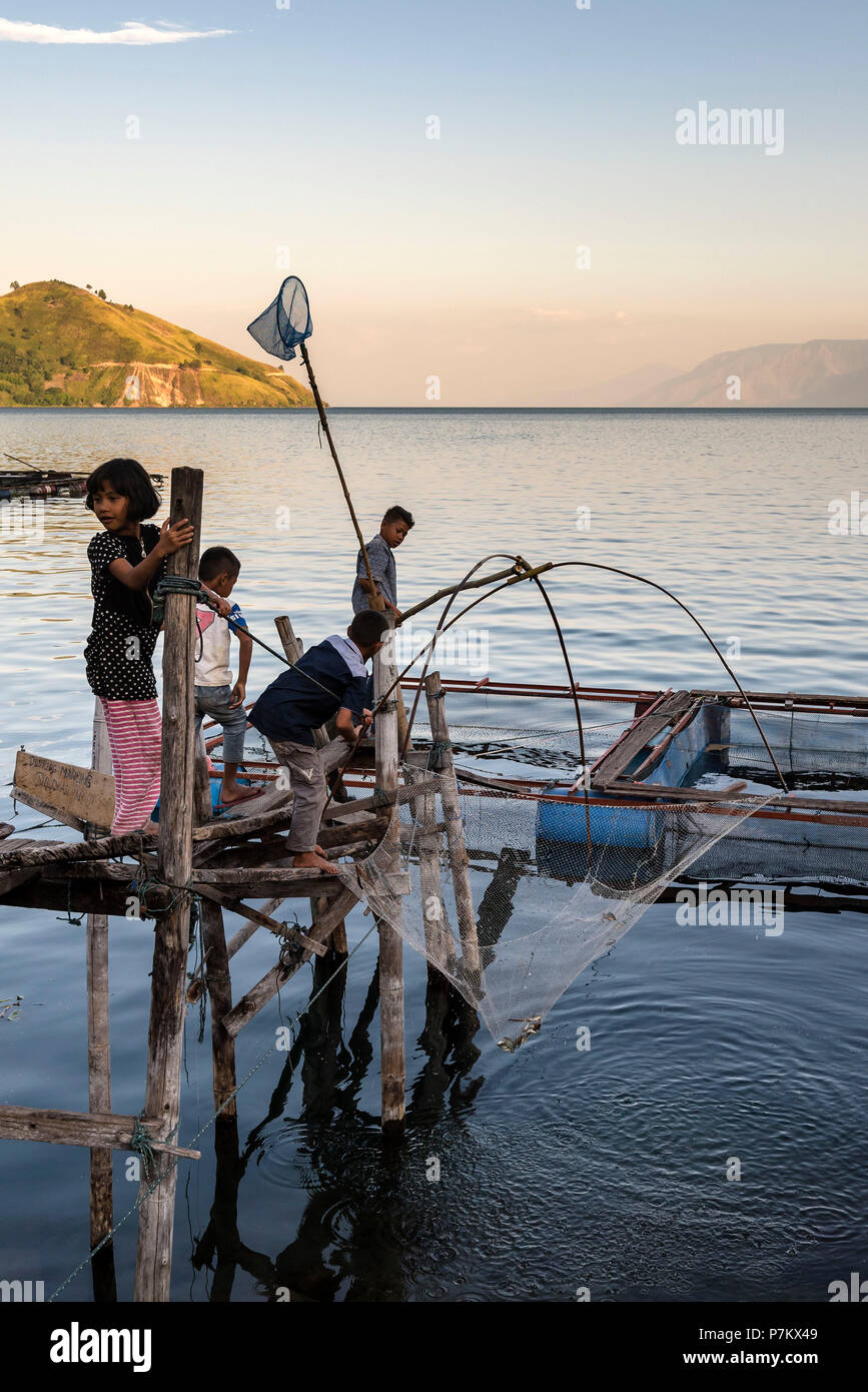 Children fishing on Lake Toba Stock Photo