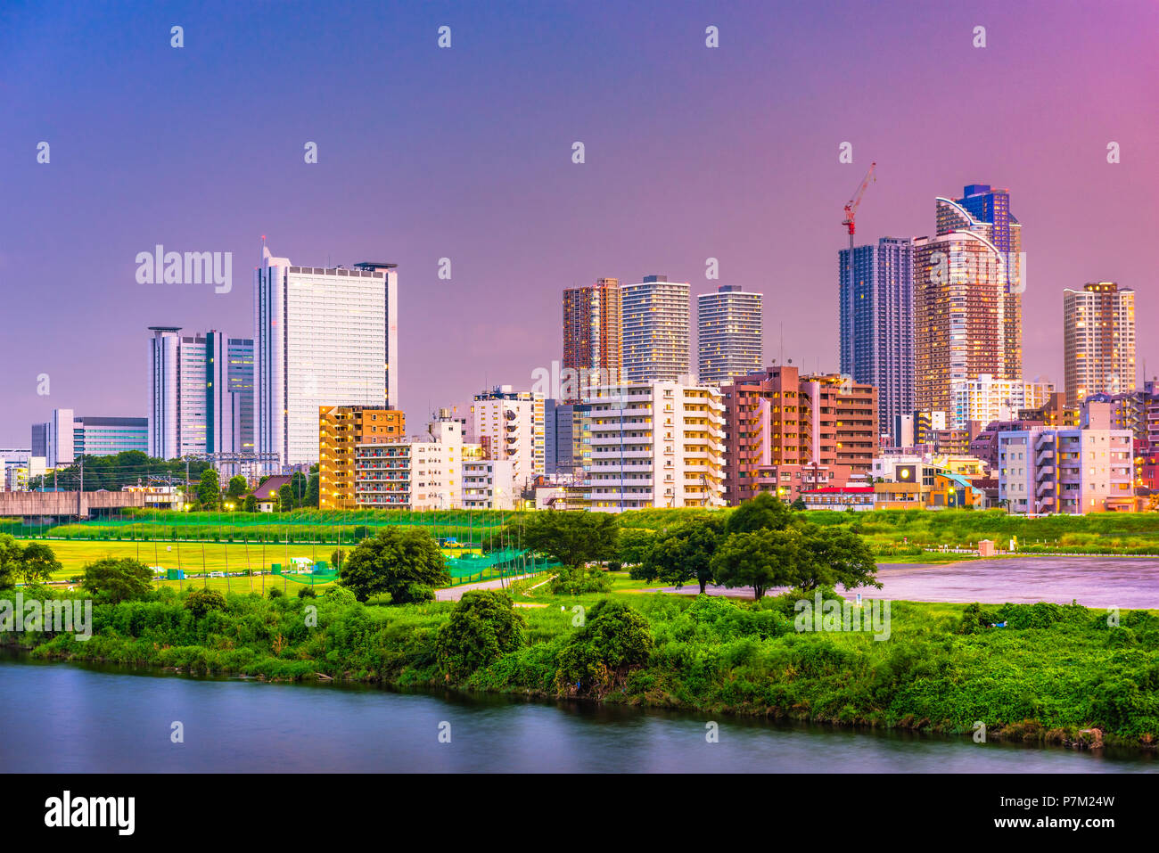 Kawasaki, Japan city skyline at dusk on the Tamagawa River. Stock Photo