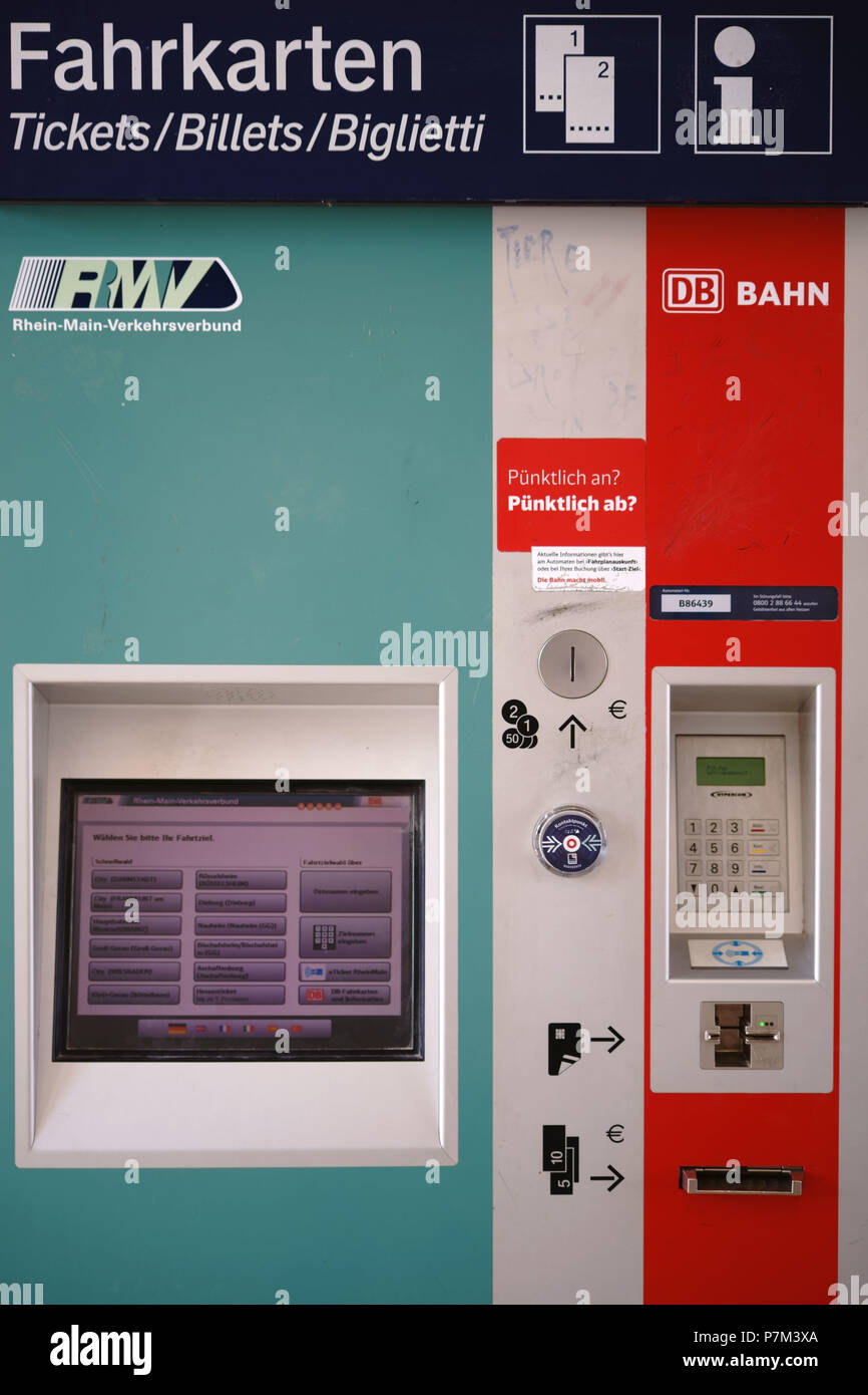 A ticket vending machine of the Rhein-Main-Verkehrsverbund RMV with a digital display and coin slot in Weiterstadt. - Stock Image