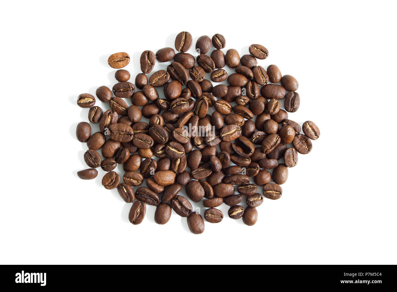 Coffee beans from above isolated on a white background. - Stock Image