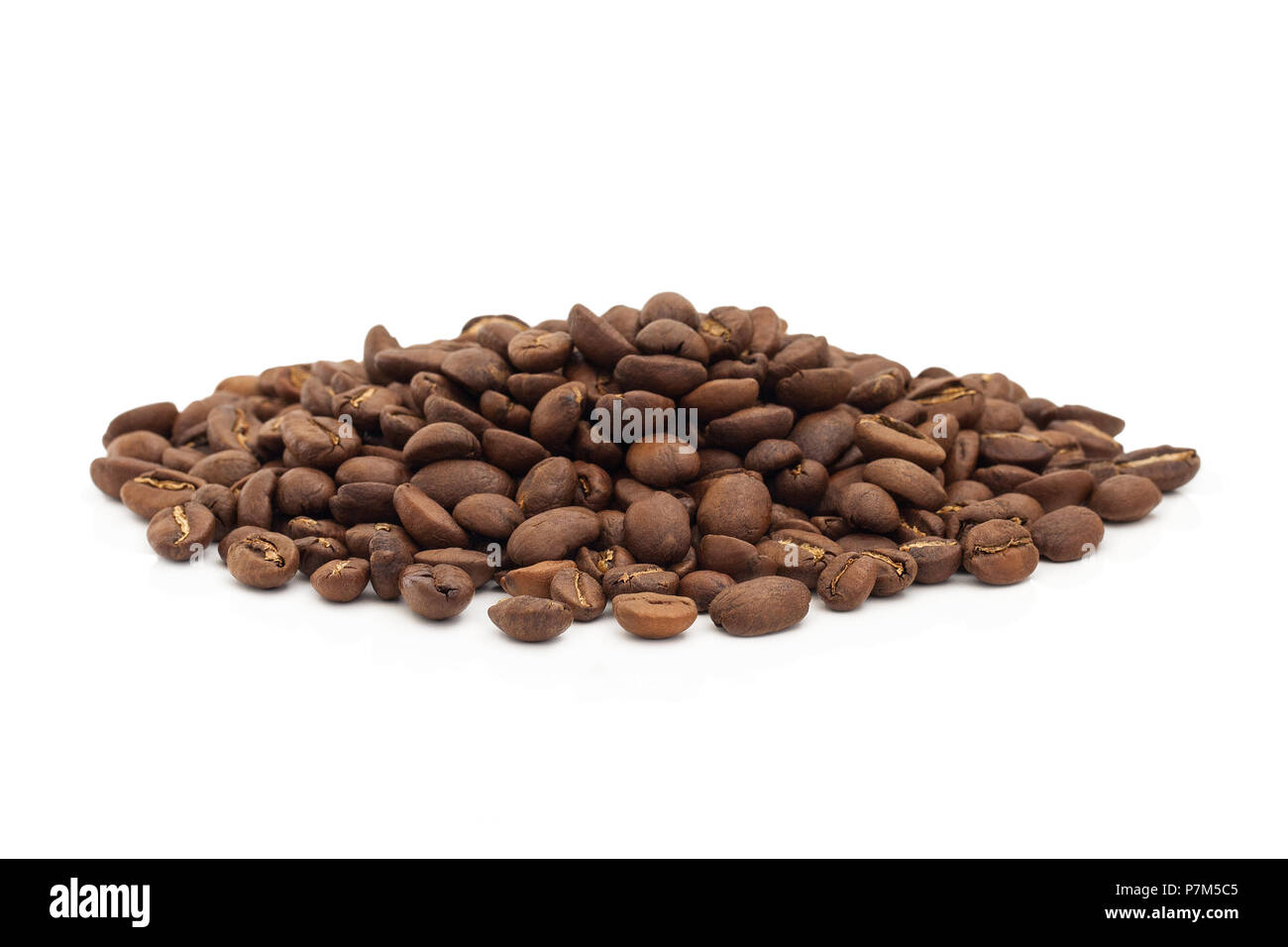 A pile of coffee beans isolated on a white background. - Stock Image