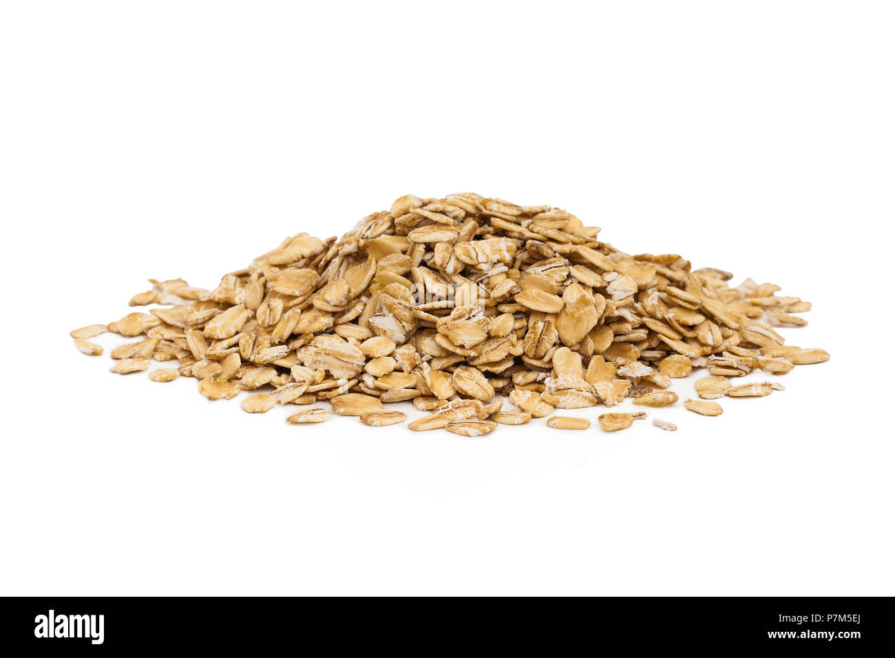 Isolated uncooked pile of oats isolated on a white background. Stock Photo