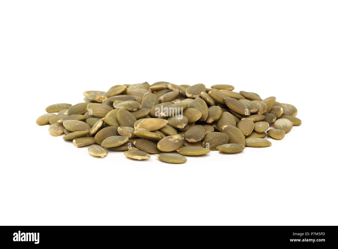 A stack of pumpkin seeds isolated on white background. Stock Photo
