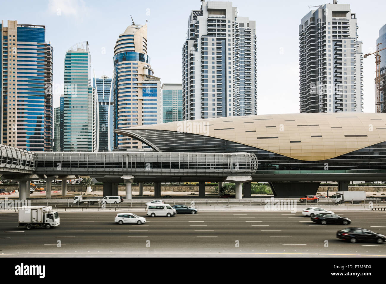 Futuristic building of Dubai metro station and highway in Dubai, United Arab Emirates - Stock Image