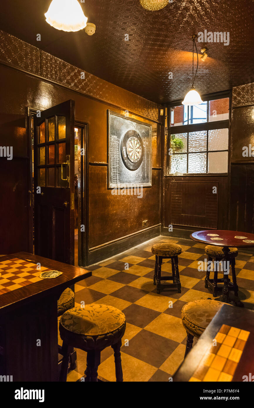 England, London, Southwark, Anchor Tap Pub, Empty Games Room with Dart Board - Stock Image