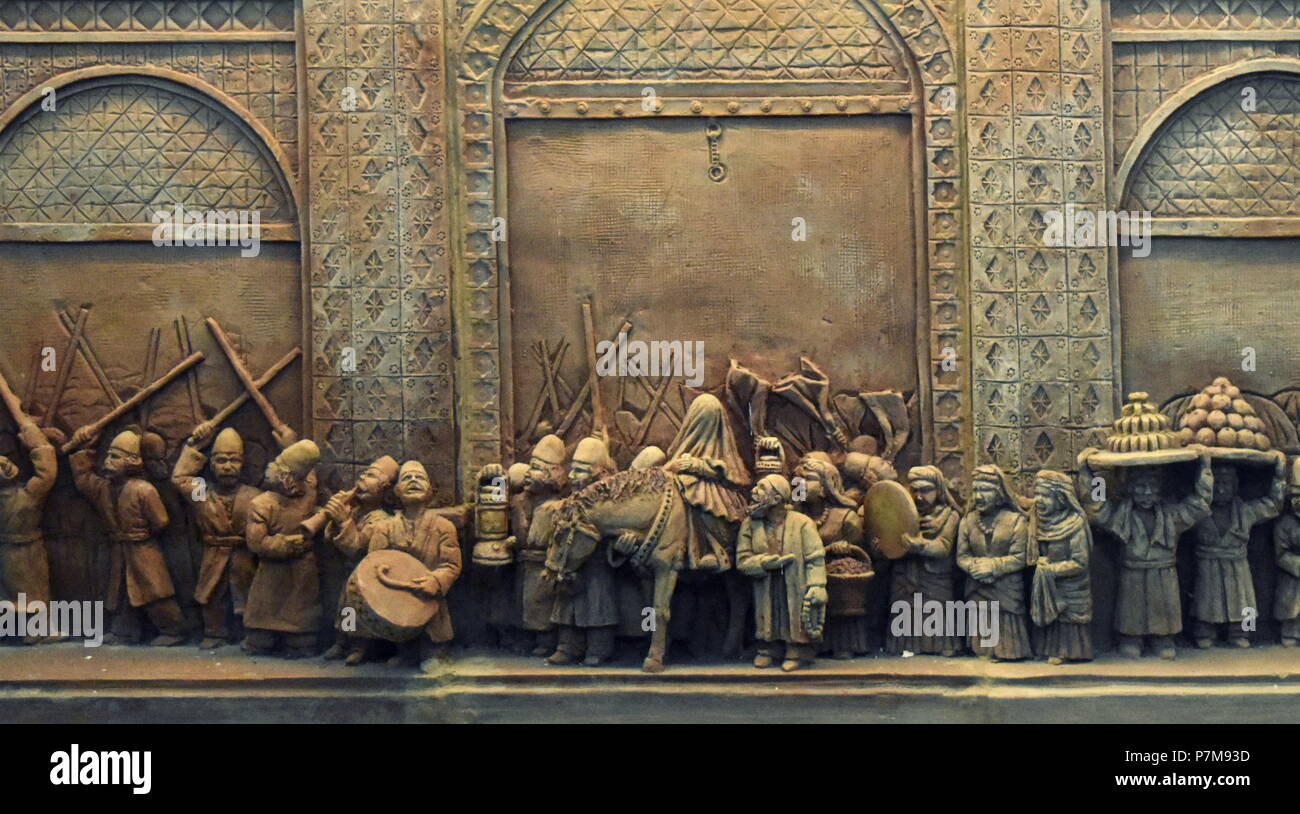 Old traditional Muslim marriage ceremony in the Middle East, carving in the Qazvin museum of Iran Stock Photo