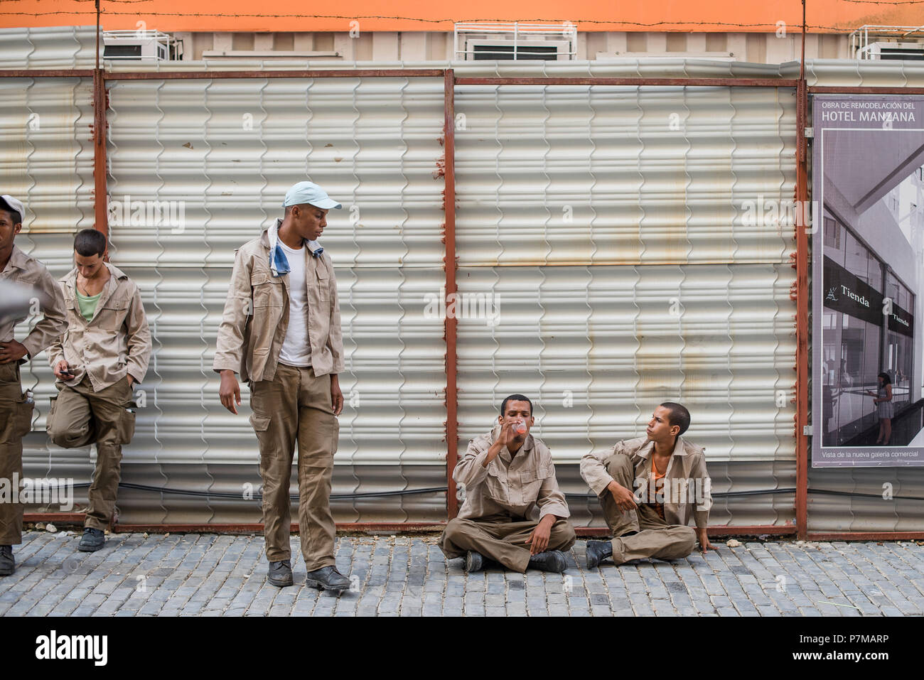 Construction workers take a break on a hot day in Havana, Cuba. - Stock Image