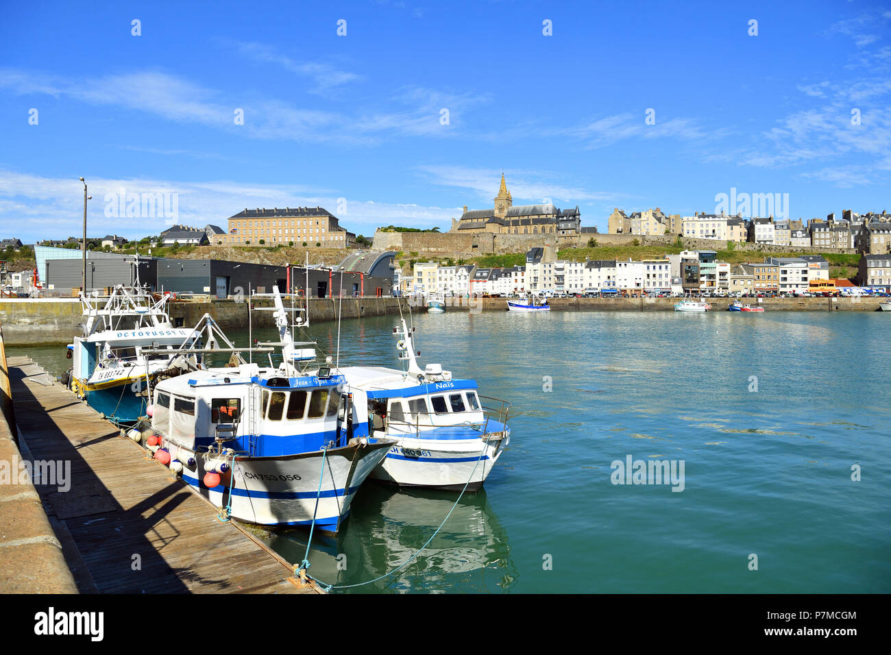 France, Manche, Cotentin, Granville, the Upper Town built on a rocky headland on the far eastern point of the Mont Saint Michel Bay, the fishing port and the Notre Dame du Cap Lihou - Stock Image