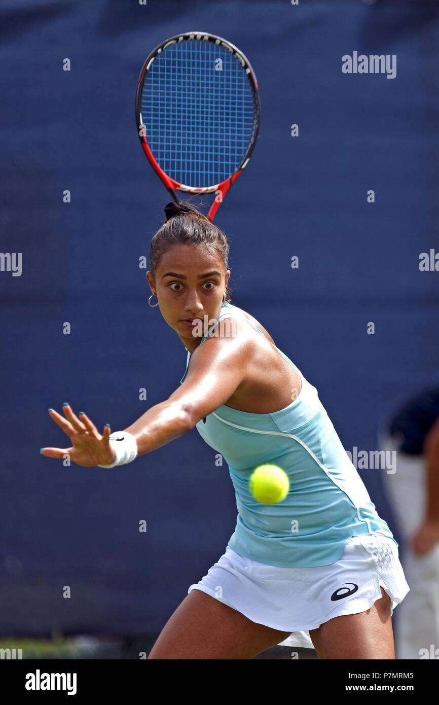 Eden Silva, a female tennis player from the United Kingdom, plays a shot during a professional match in 2018. Stock Photo