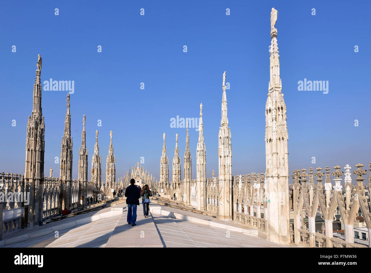Italy, Lombardy, Milan, Piazza del Duomo, the Cathedral of the Nativity of the Holy Virgin (Duomo) built between the 14th century and the 19th century is the third largest church in the world, spires and statues of the Duomo seen from the terrace on the roof of the cathedral Stock Photo