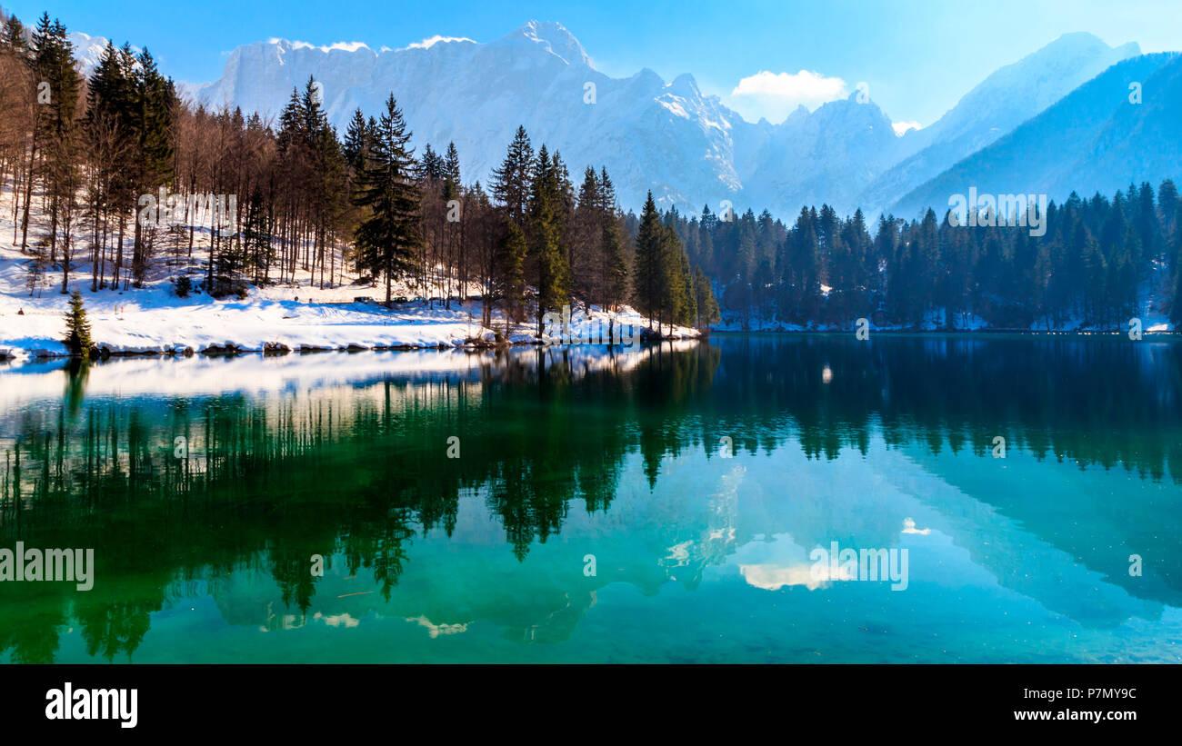 The inferior lake of Fusine, Udine province, Friuli Venezia-Giulia Region, Italy, in a winter afternoon. - Stock Image