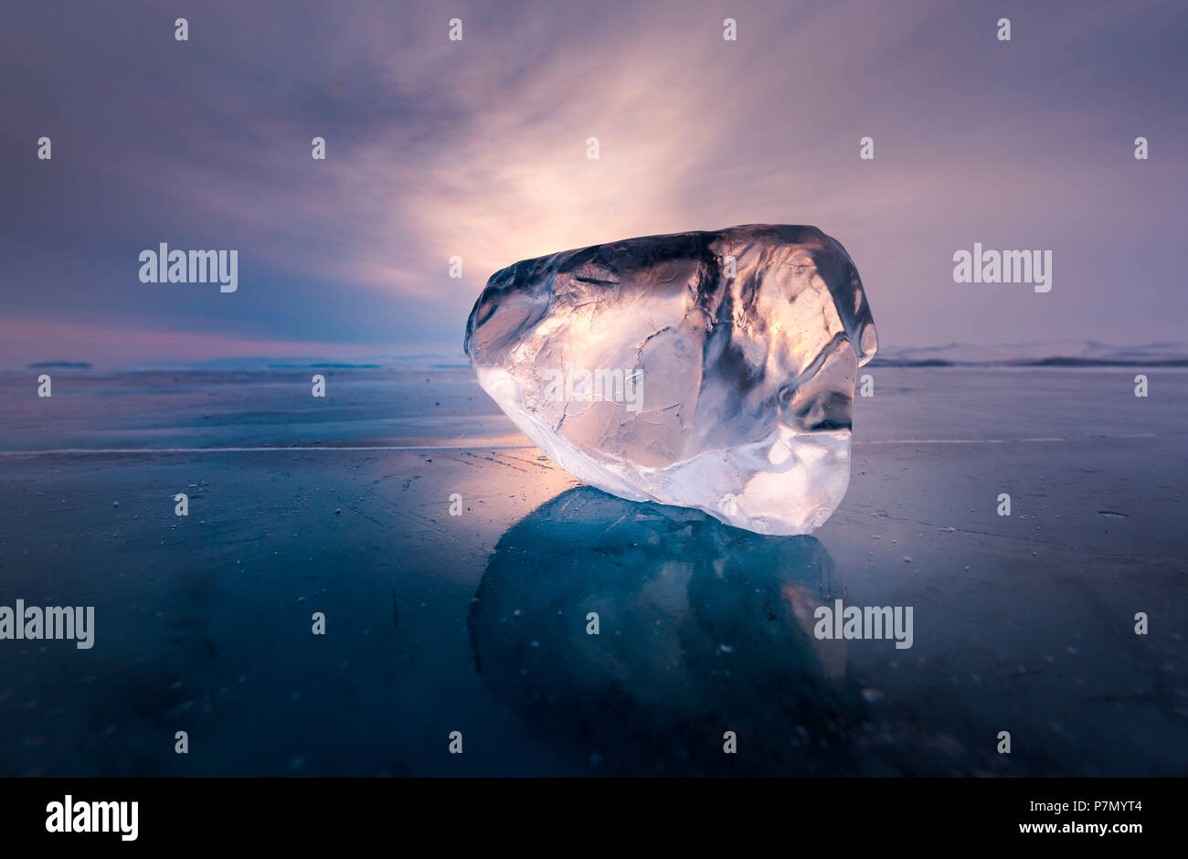 Piece of ice with sun reflection at lake Baikal, Irkutsk region, Siberia, Russia - Stock Image
