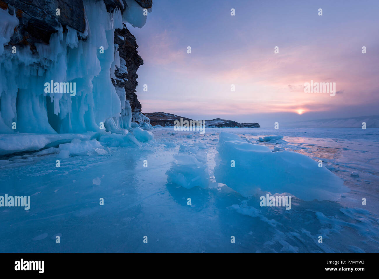 Pieces of ice at sunset at lake Baikal, Irkutsk region, Siberia, Russia - Stock Image