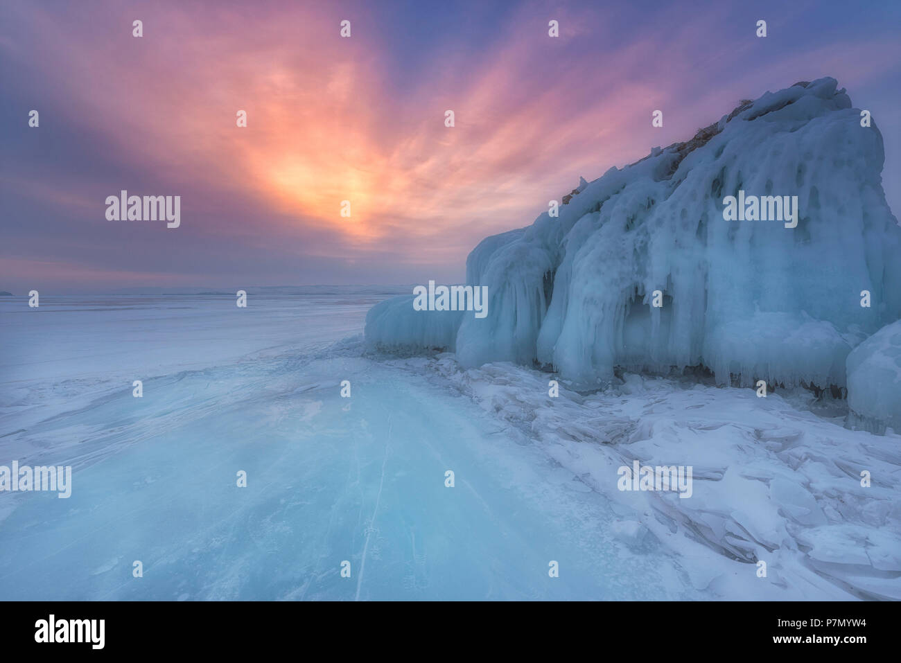 Ice mountain at sunrise at lake Baikal, Irkutsk region, Siberia, Russia - Stock Image