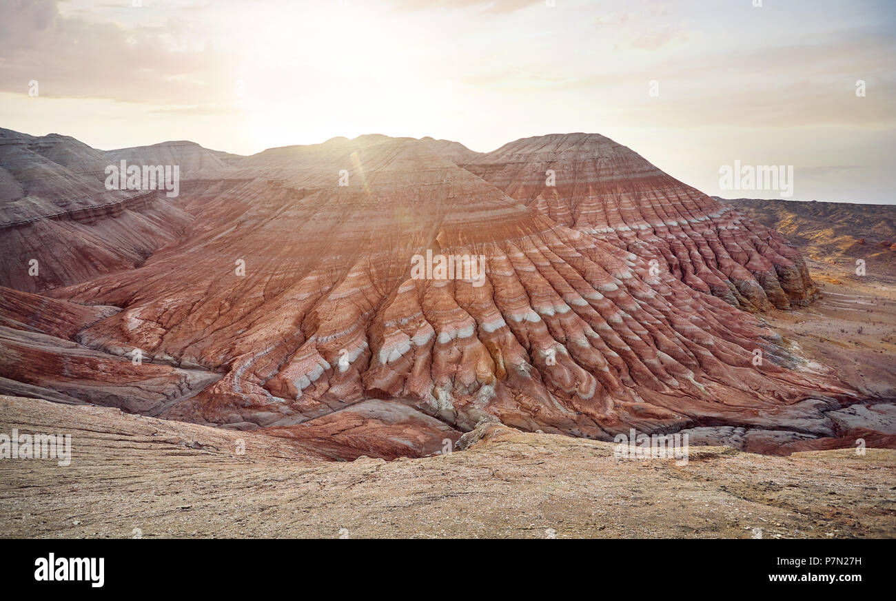 Aerial view of Red striped mountains pyramid shape at sunrise in desert park Altyn Emel in Kazakhstan - Stock Image