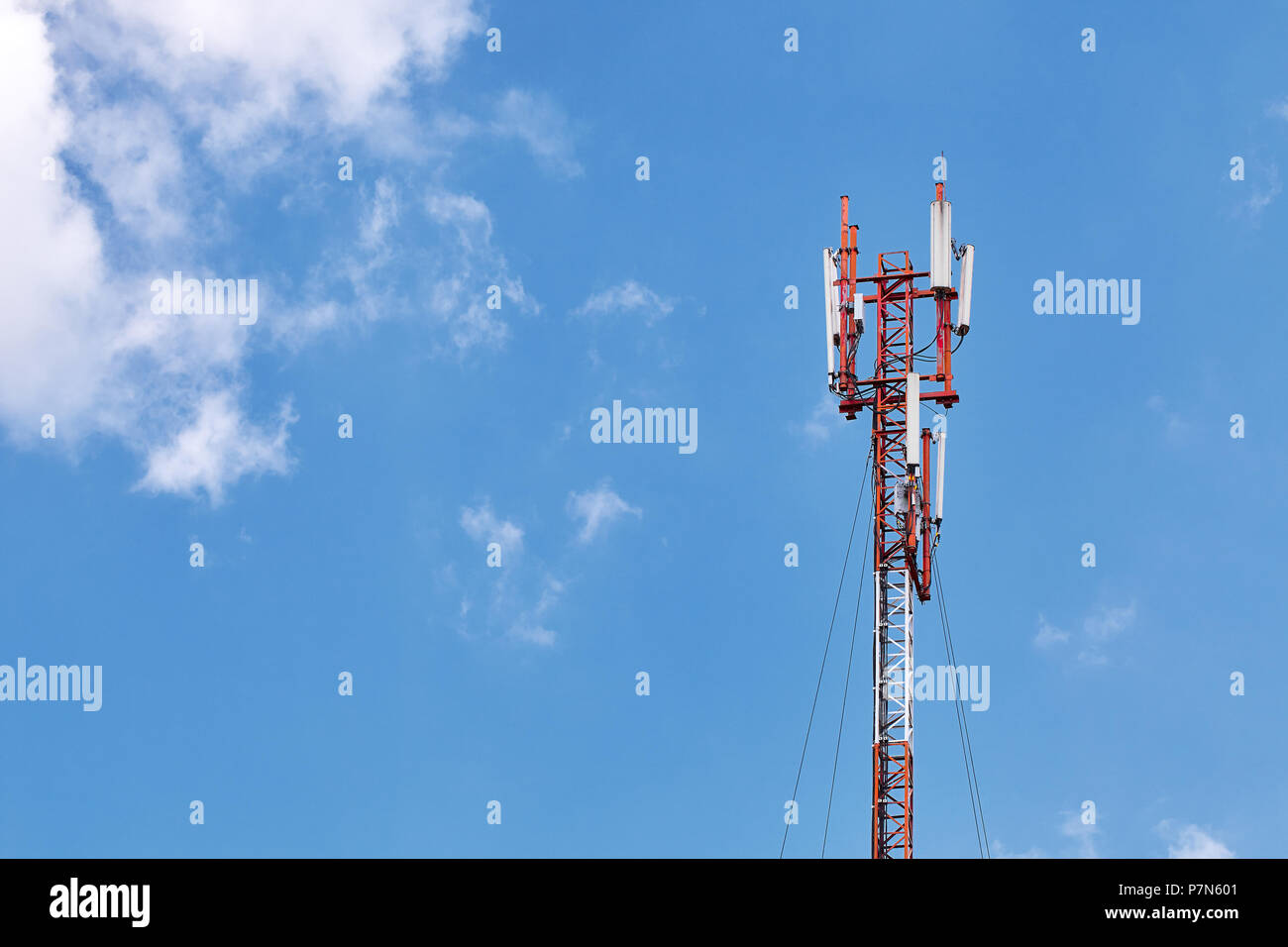Technology on the top of the telecommunication GSM (5G,4G) tower with copy space. Cellular phone antennas on a building roof - Stock Image