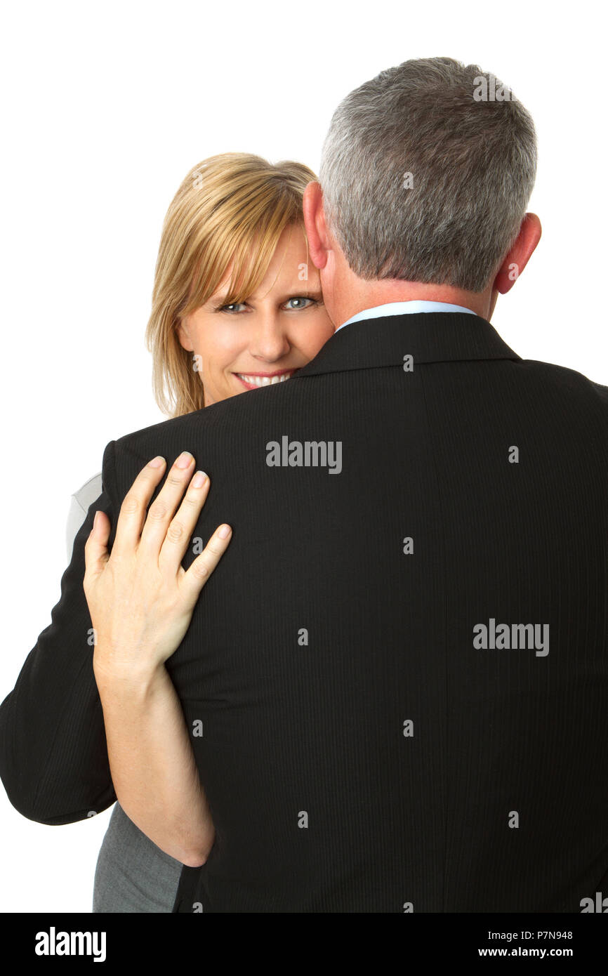 Well dressed mature couple isolated on white. - Stock Image