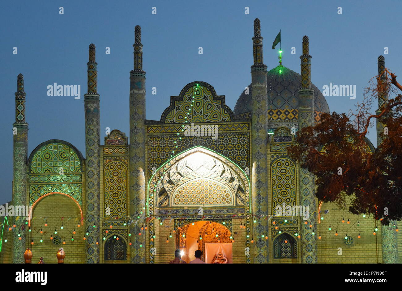 Beautiful Islamic and Iranian architecture of Shia shrine at dusk in Qazvin, Iran - multiple minarets and large dome - Stock Image