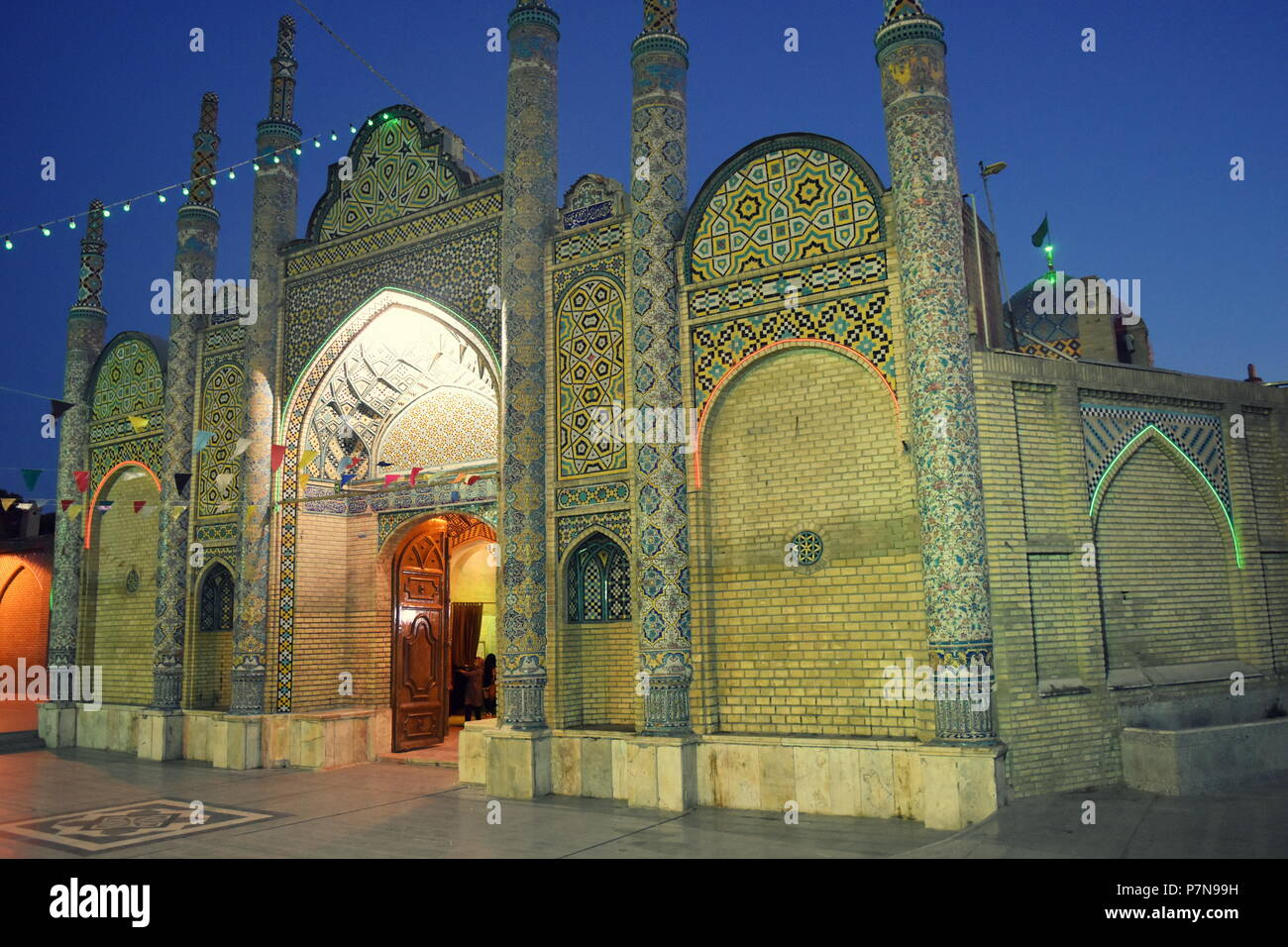 Beautiful architecture of old Shia Islamic shrine and mosque with typical Middle Eastern and Persian architecture at dusk in Qazvin, Iran - Stock Image