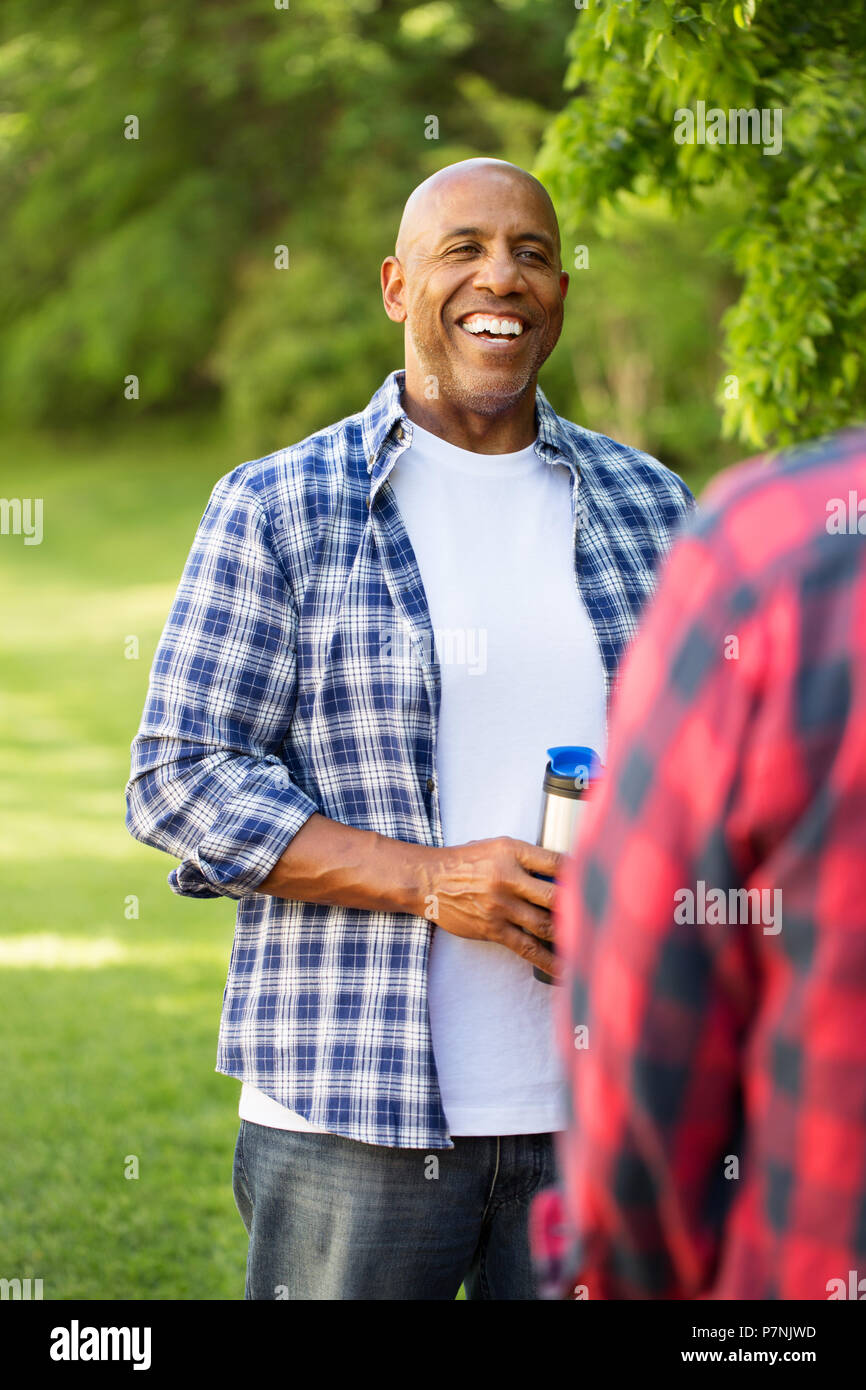 Friends talking and camping. - Stock Image
