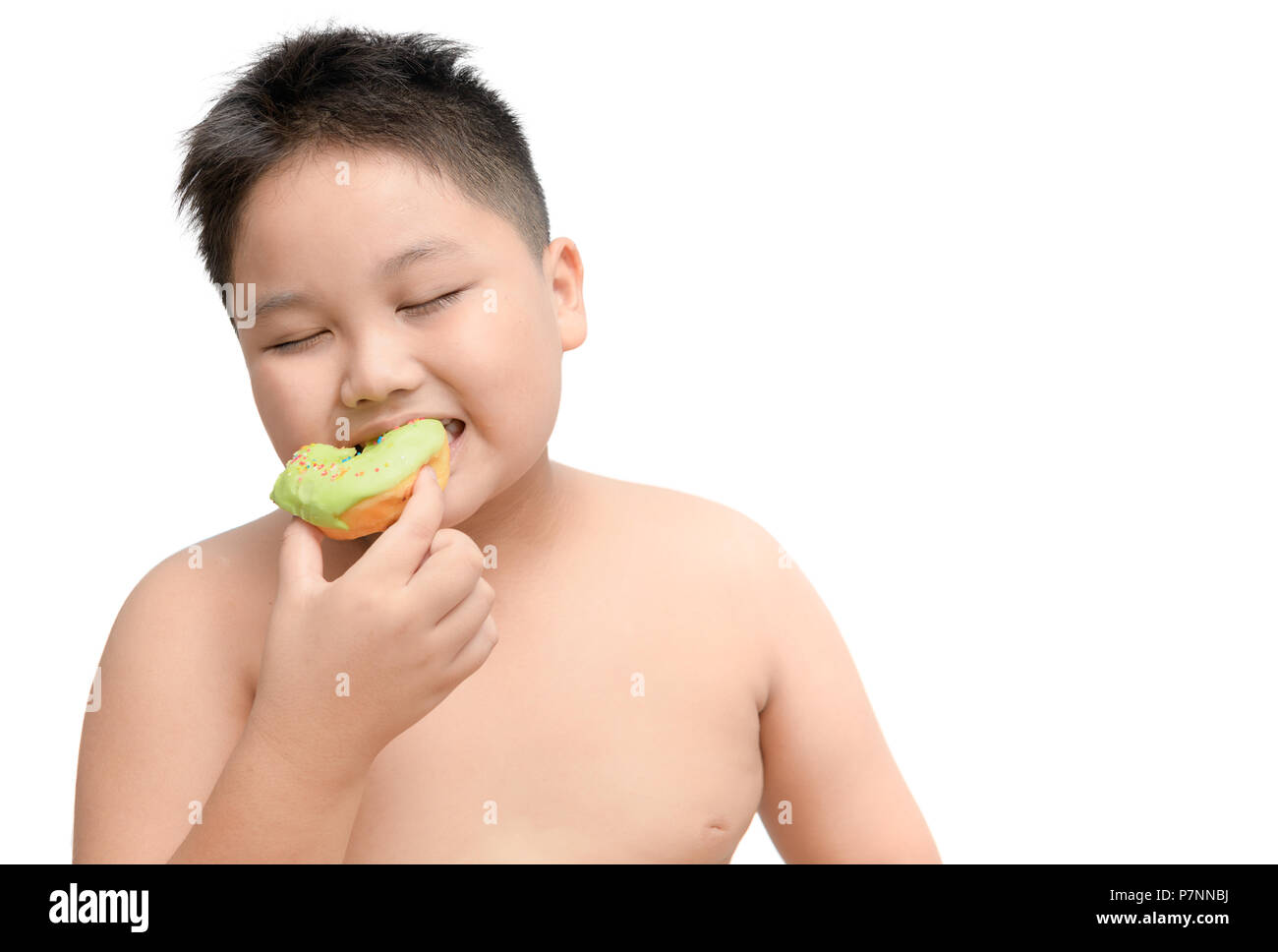 Obese fat boy enjoy to  eating donut isolated on white background, junk food and dieting concept - Stock Image