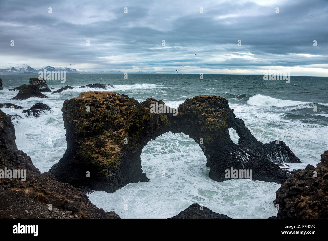 Gat Velcro, arch in the sea, waves at the sea, bad weather, West Iceland, Iceland - Stock Image