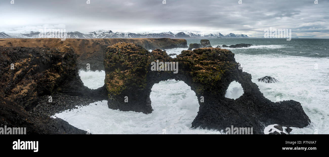 Gat Velcro, rock arch in the sea, waves at the sea, bad weather, West Iceland, Iceland - Stock Image