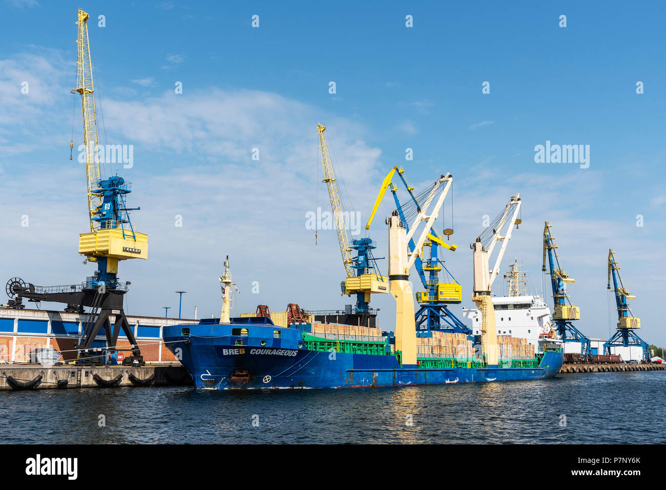 Cargo ship and cranes at the overseas port, Wismar, Mecklenburg-Western Pomerania, Germany - Stock Image