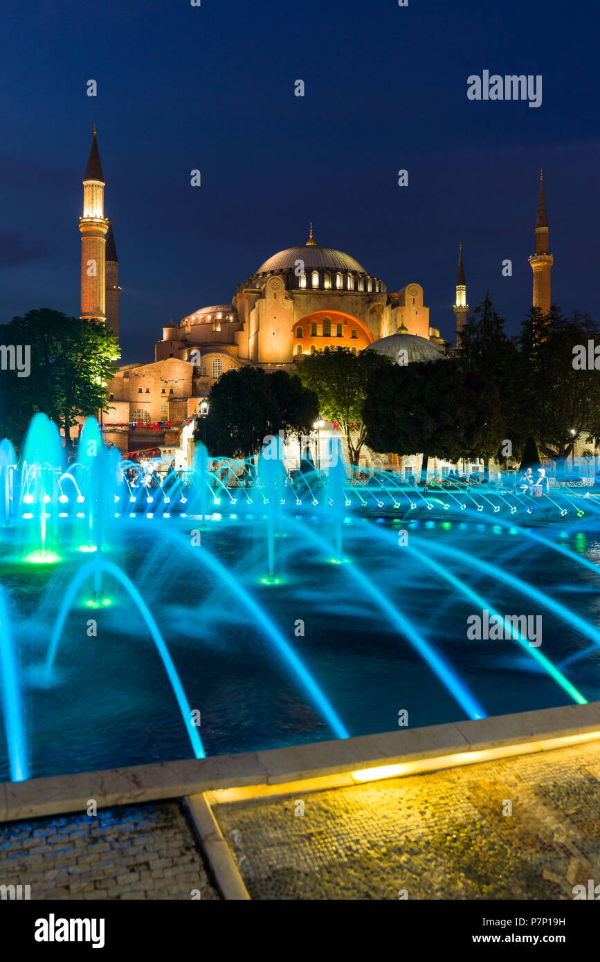 The Sultan Ahmad Maydan water fountain lit up with the Hagia Sophia museum in background at dusk, Istanbul, Turkey Stock Photo