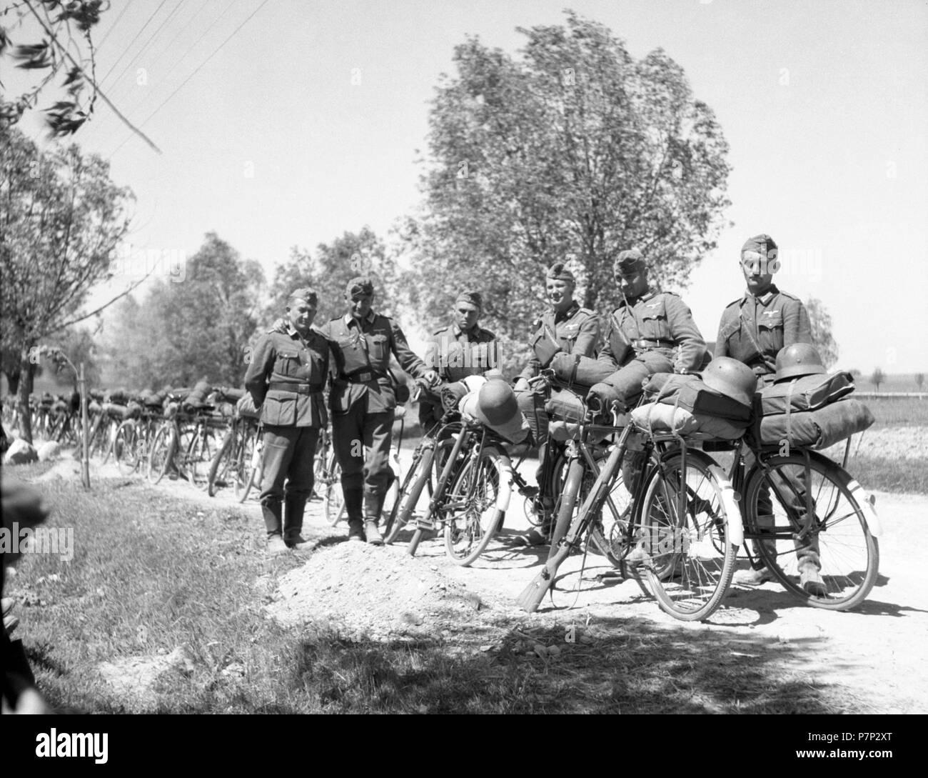Approx. 1939,1941, training Wehrmacht, soldiers posing for a photo with parked bicycles, Ulm, Germany - Stock Image