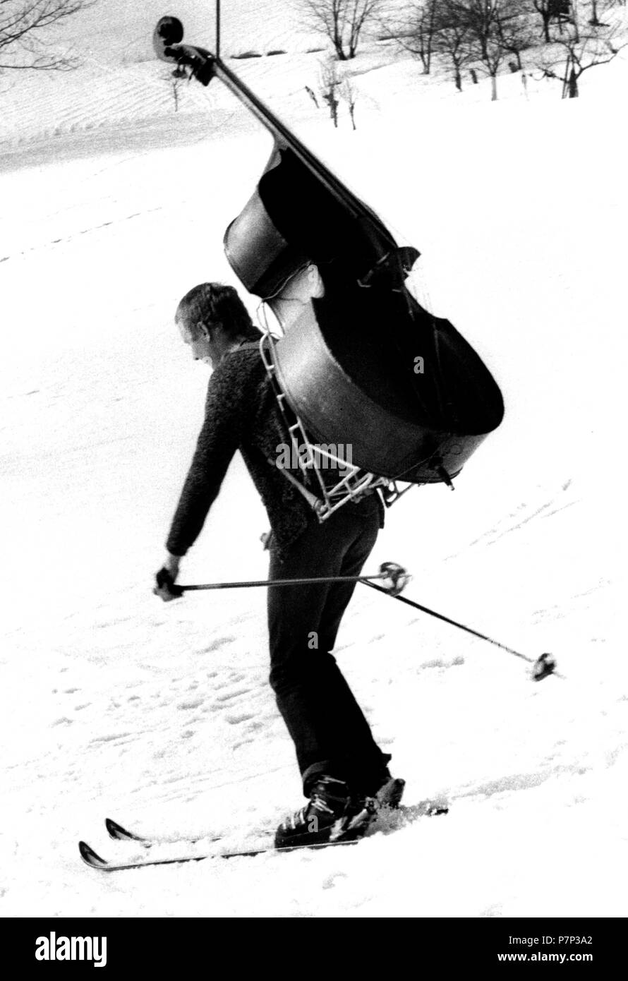 Man is skiing with bass ca. 1970s, exact place unknown, Czech Republic - Stock Image