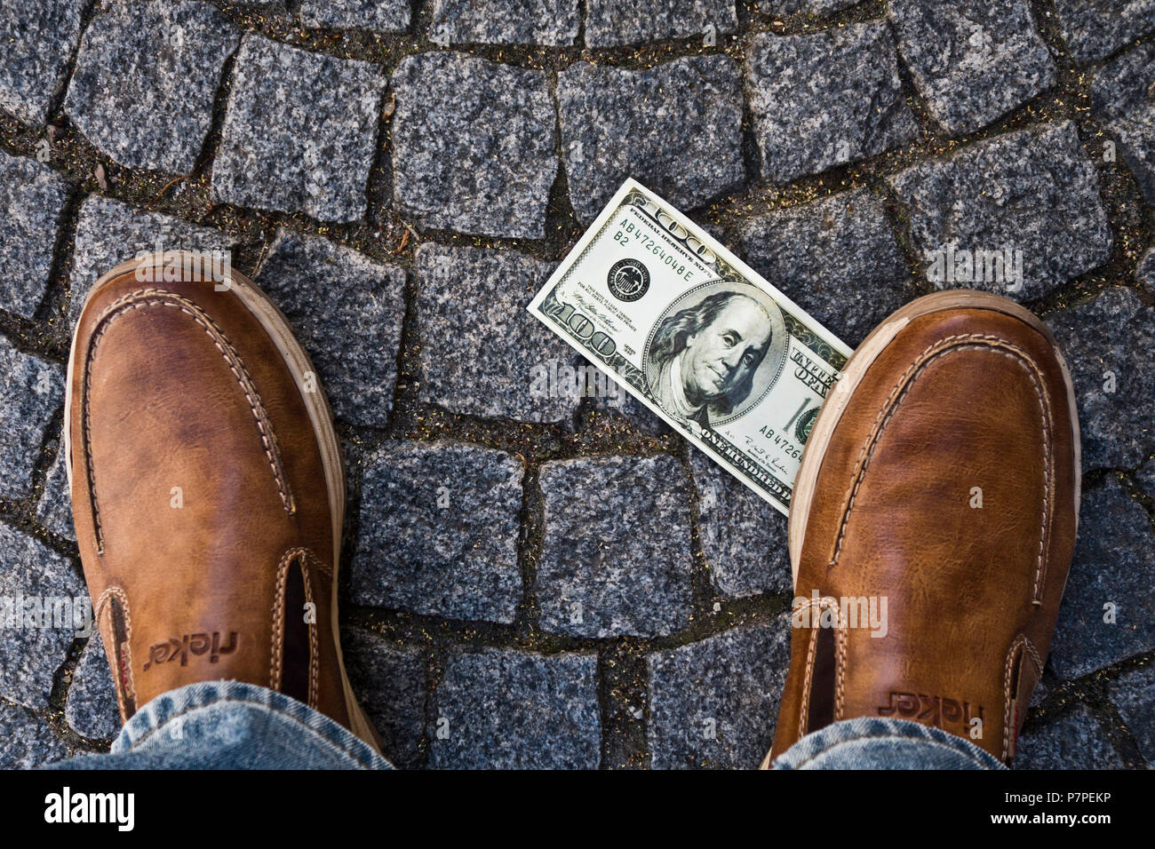 finding a dollar banknote in the street - Stock Image