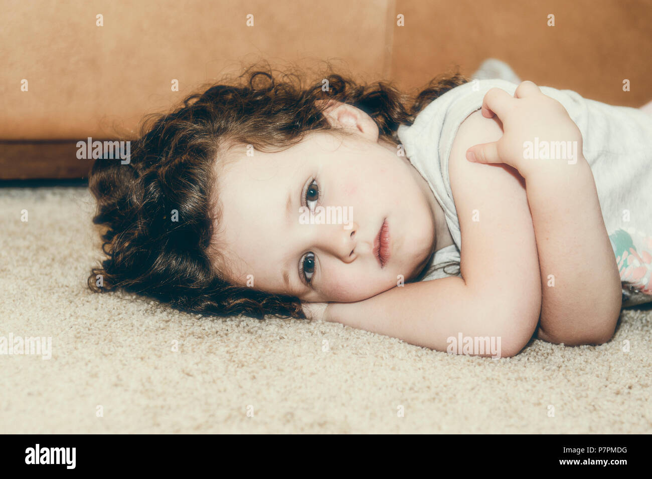 Portrait of Beautiful Three Year Old Looking Sad & Solemn - Stock Image