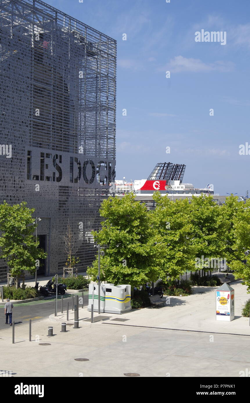 Fabulous metal screen with cut out lettering on one end of the former Warehouse which is now Les Docks Village, a Marseille shopping and office centre Stock Photo
