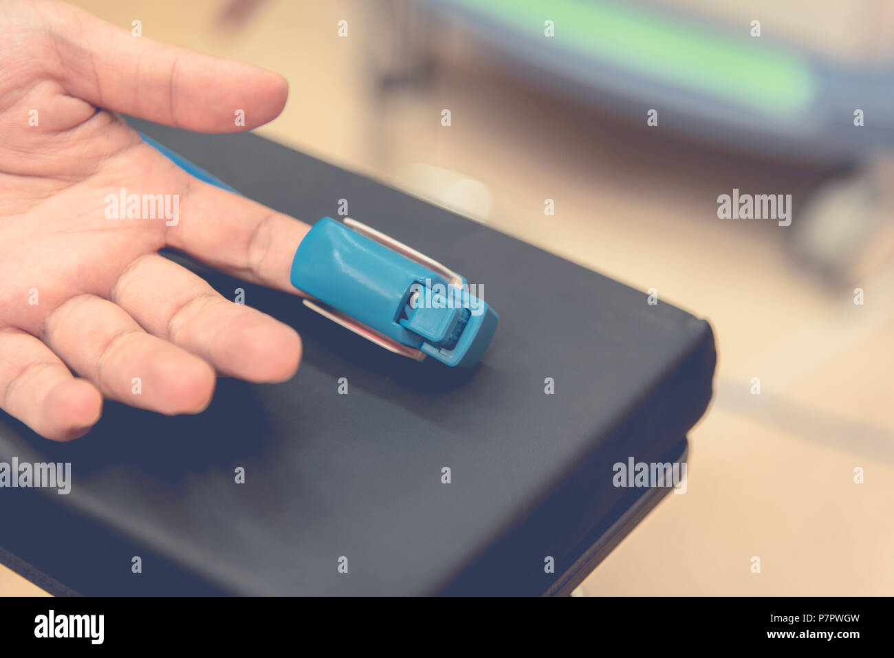 Cardiac finger pulse rate meter for check heart beat and output to monitor. Medical and Healthcare concept. Doctor and patient theme - Stock Image