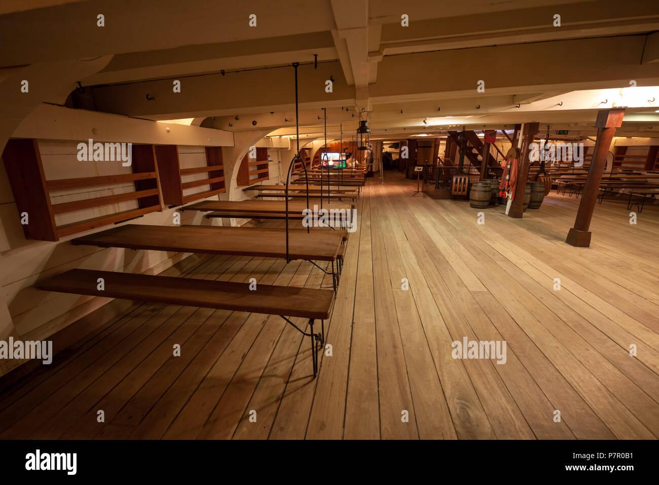 Fragata D. Fernando II e Gloria ship interior, tables in mess hall, frigate of the Portuguese Navy in Cacilhas, Almada, Portugal, 19th century sailing - Stock Image