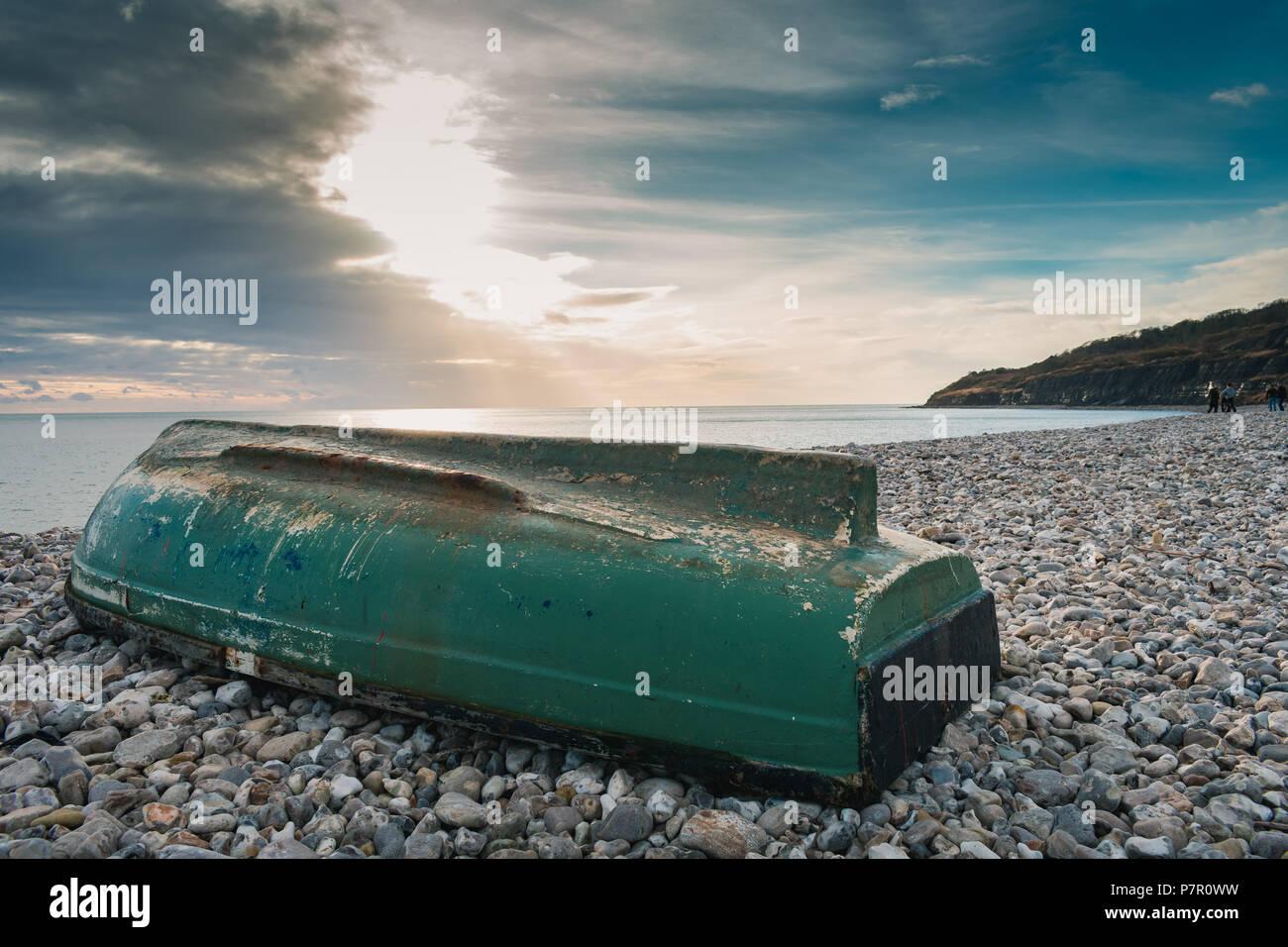 Upturned boat on Monmouth Beach in Lyme Regis, Dorset, UK - Stock Image