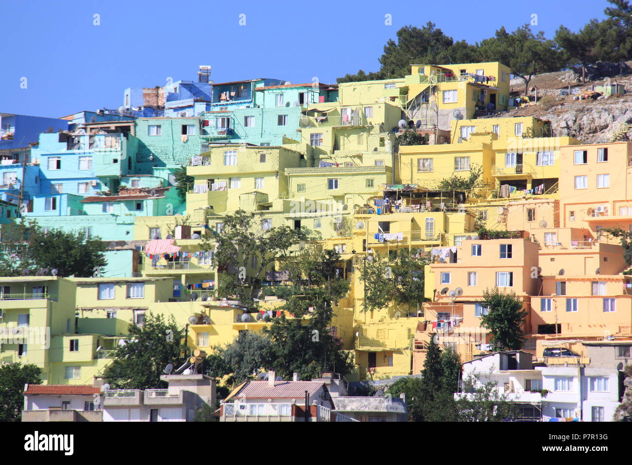 multi coloured painted houses on the hillside overlooking the town
