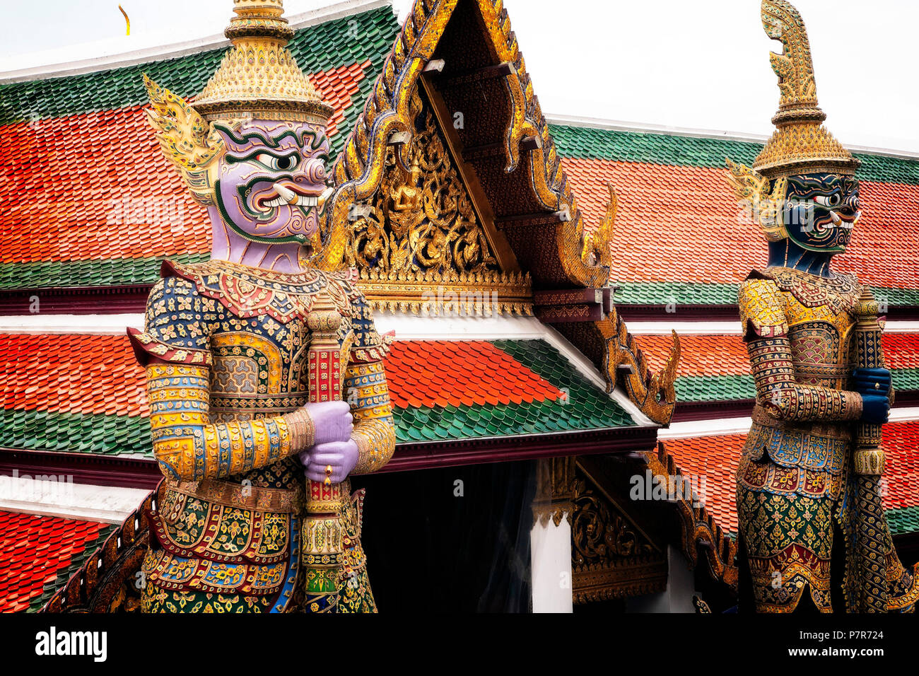 Statues scare away demons at the Grand Palace complex.  Bangkok, Thailand. - Stock Image