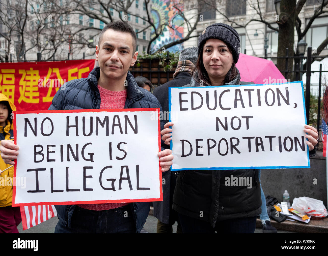Two Hispanic Americans holding signs against deportation at a pro immigration ant-Trump Rally at Herald Square in Manhattan, New York City. Stock Photo