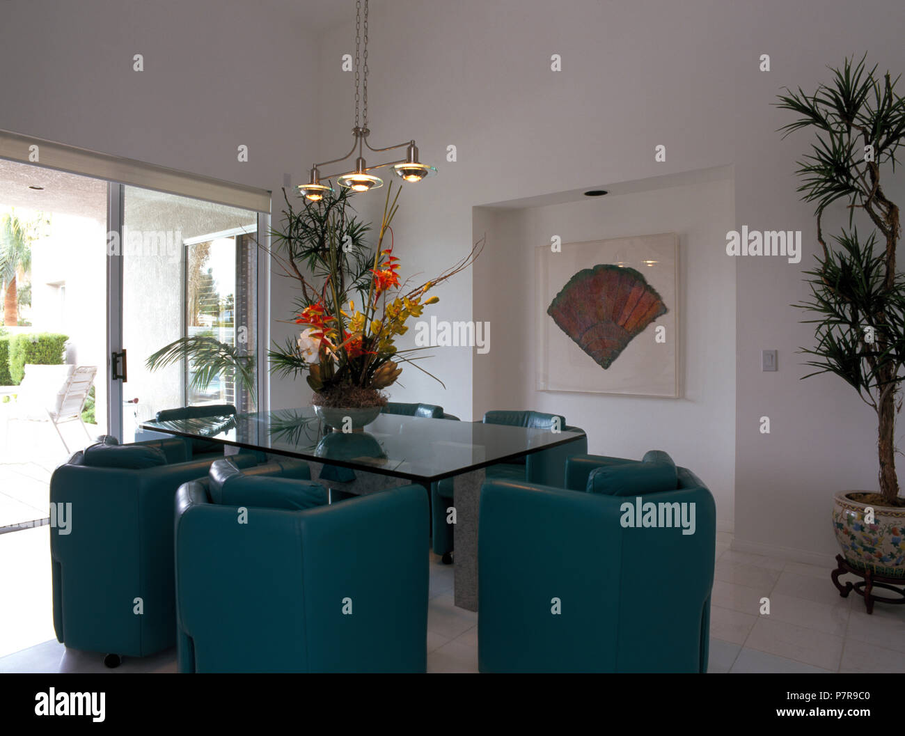 Blue Grey Upholstered Leather Armchairs At Glass Table In Modern Dining Room